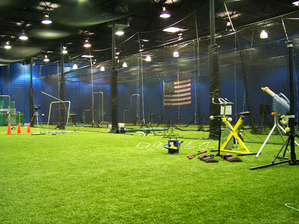 Netservices golf netting installation golf barrier netting for Design indoor baseball facility